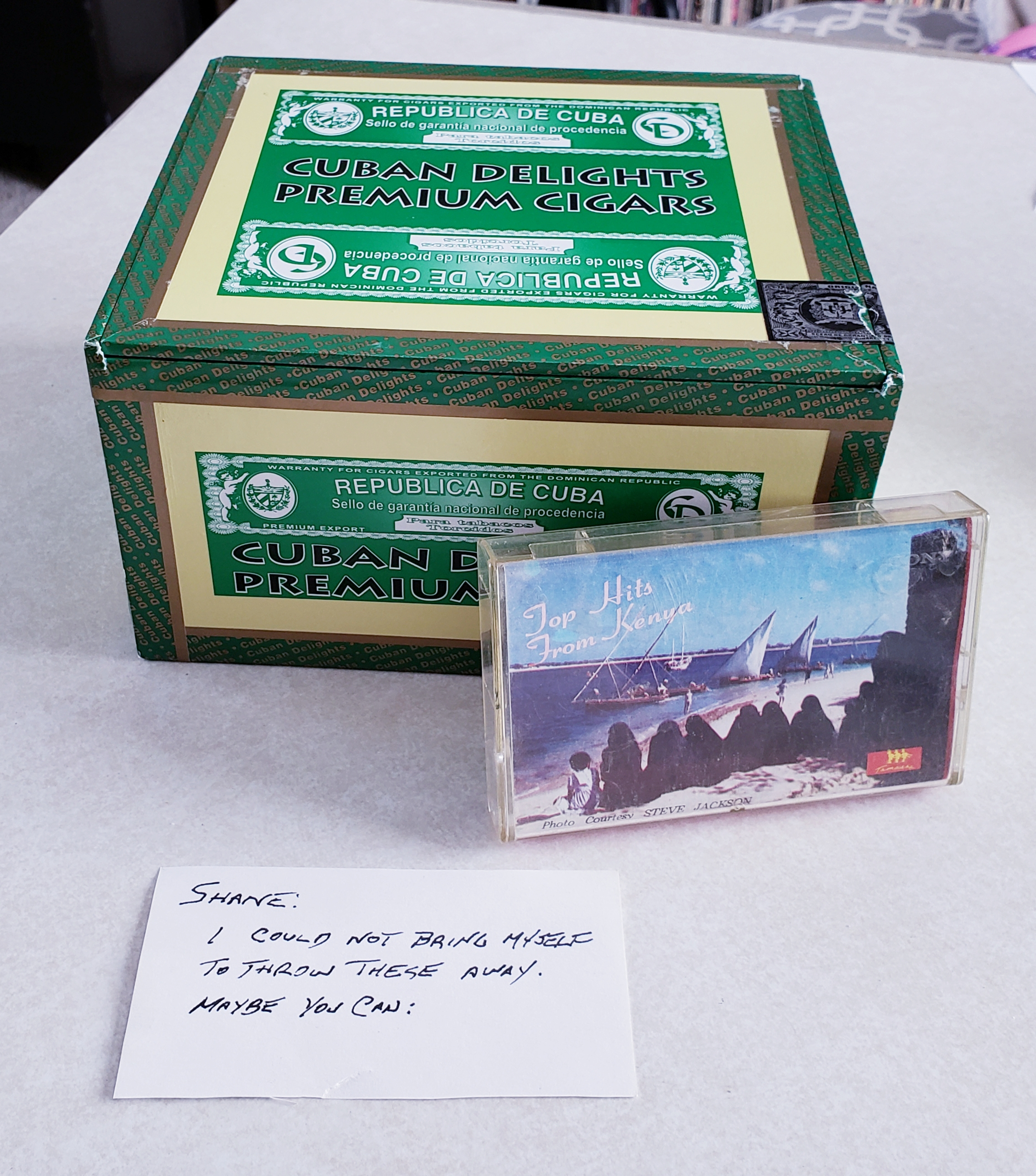 cigar box, cassette, and note